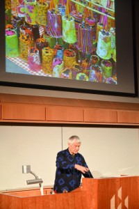 Kaffe Fassett delivers his lecture in front of an image of printed fabric lanterns used to promote his recent exhibition at The American Museum in Bath.